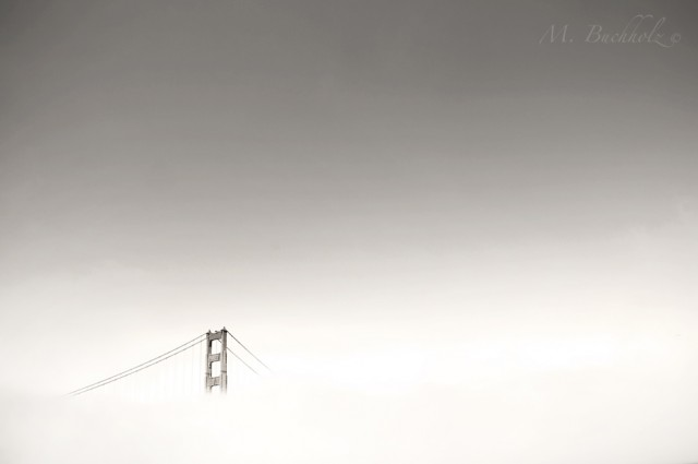 Golden Gate Bridge in fog; San Francisco, California